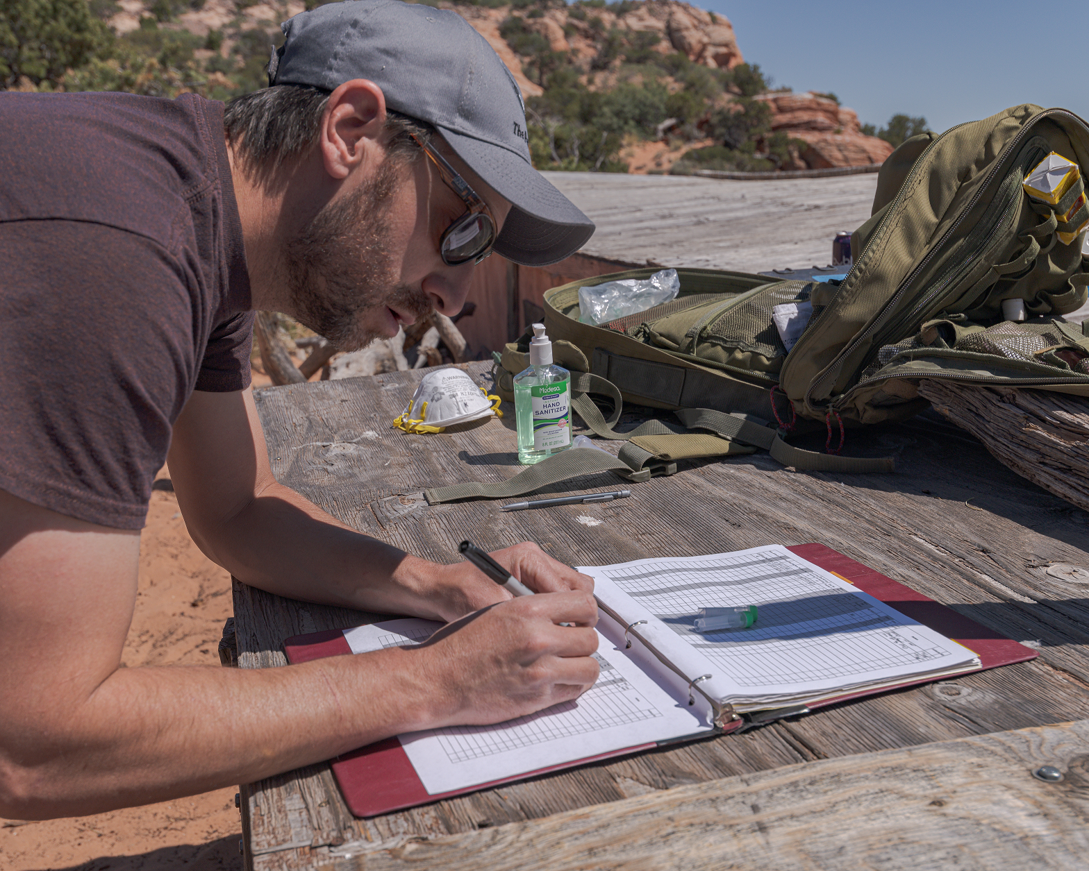 Biologist and Program Lead Tim Hauck records Condor 1K's weight and other data collected