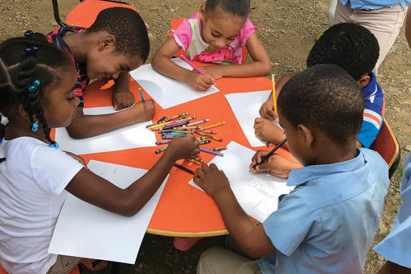 children draw hawks in the Dominican Republic