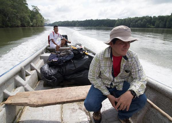A biologist travels by boat to reach the Darien region of Panama