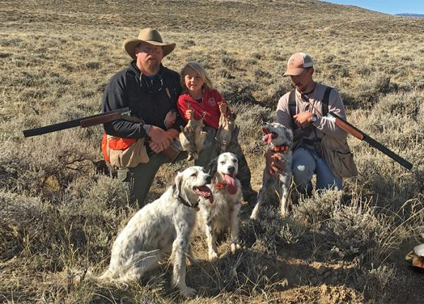 Hunters in the field with dogs