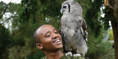 student Washington Wachira with a Verreaux's Eagle-owl